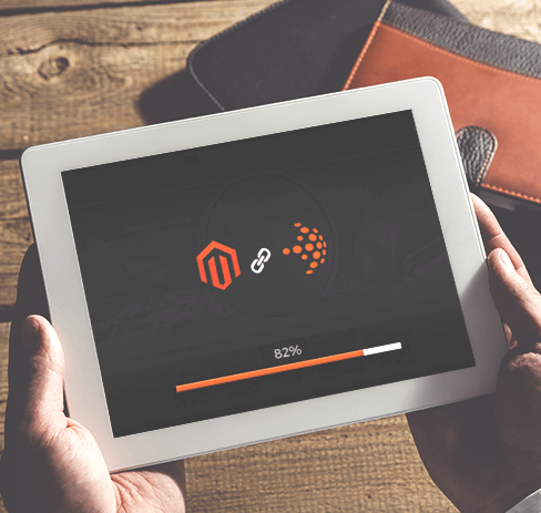 tablet display showing magento and nfusion solutions logo